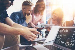 A Team of Brainstorming Digital Marketing Specialists
