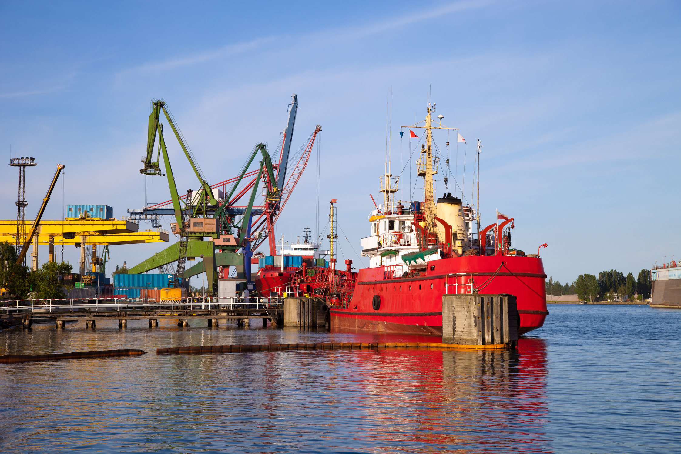 Cargo ship docked by the port