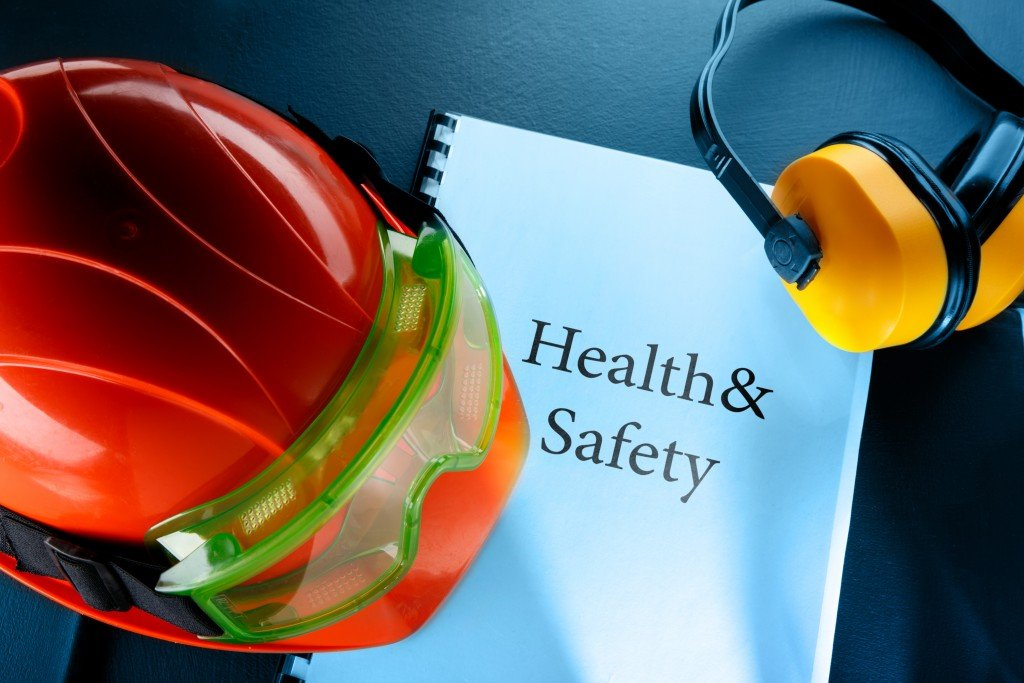 Safety hats and goggles over a health and safety book