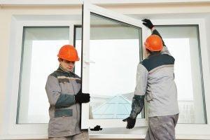 Men installing glass window