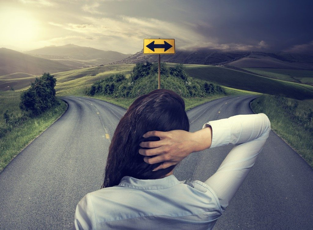 Woman Deciding Road to Take
