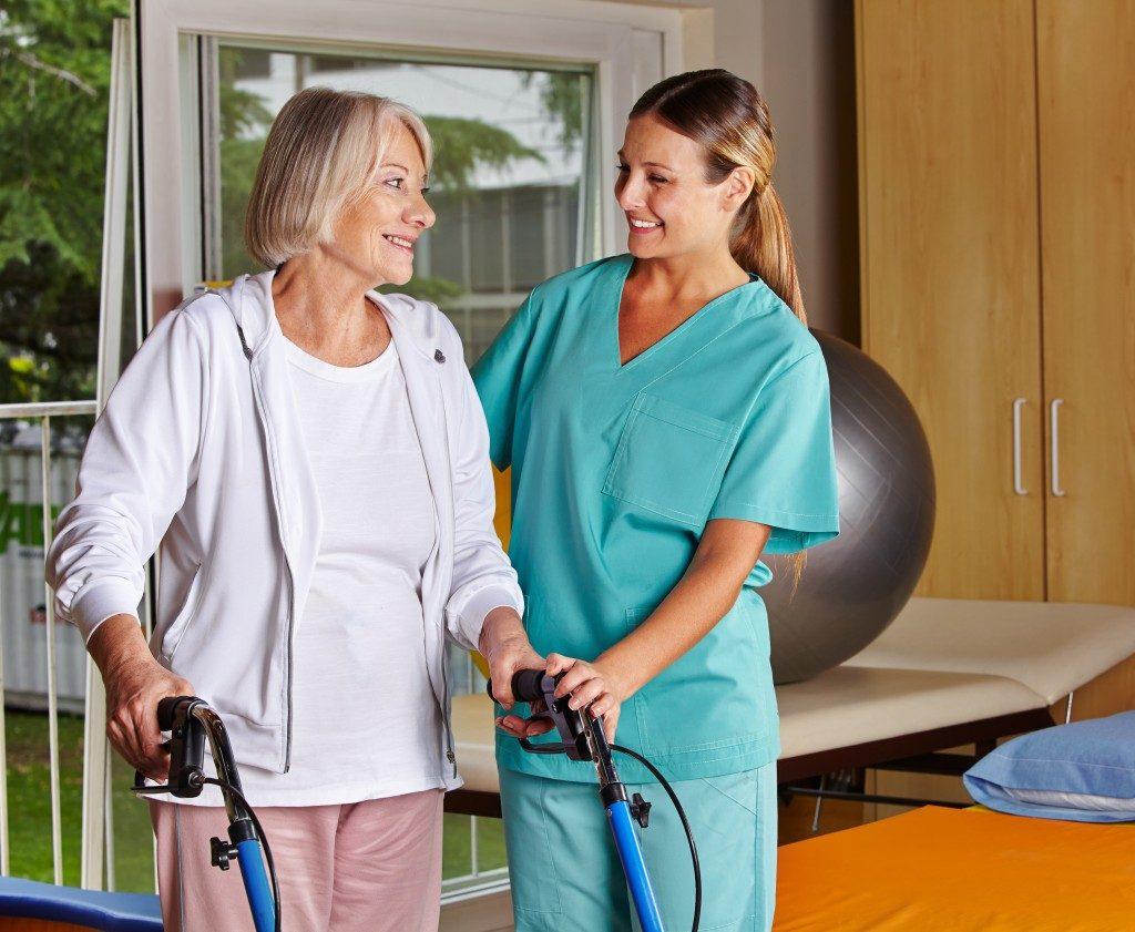 Nurse Assisting a Senior Woman
