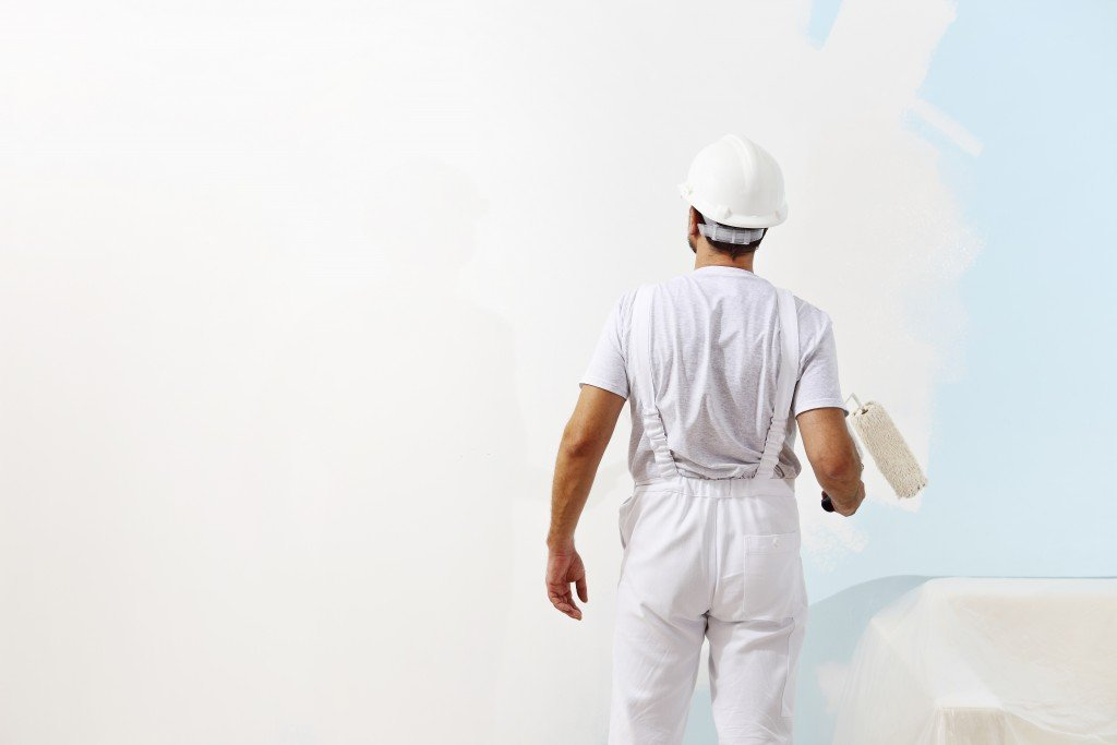 Man painting the office walls