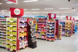 grocery aisles with special offer signs
