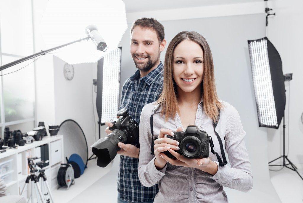 Professional photographers in studio