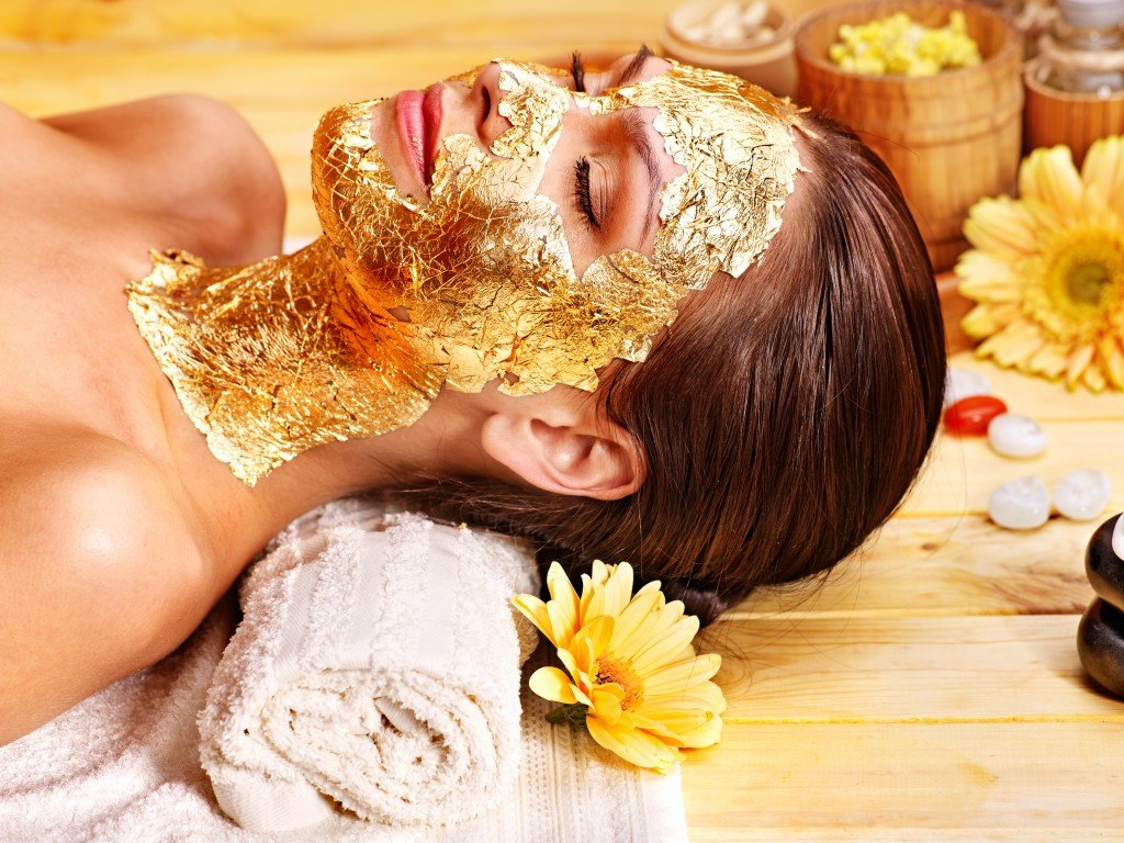 Gold facial mask on woman