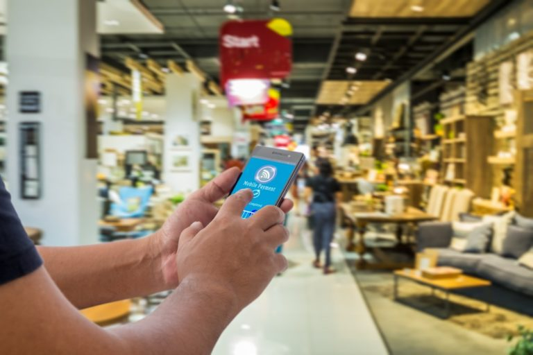 Man using NFC in the store