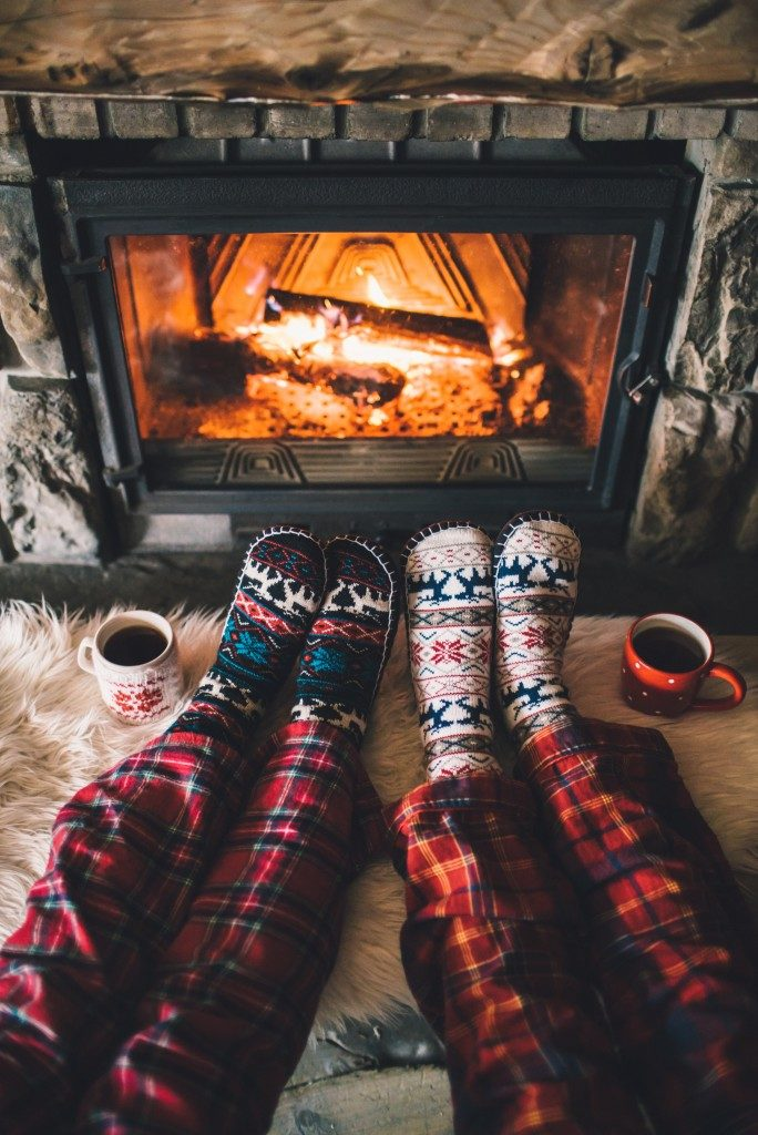 couple enjoying the warmth of their fireplace