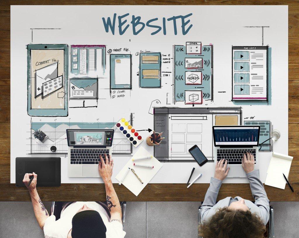 Web developers designing website structure