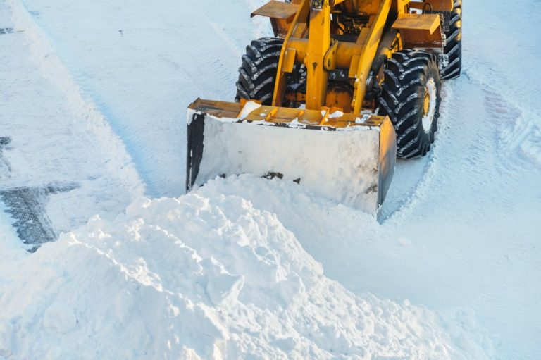 Tractor clearing the snow