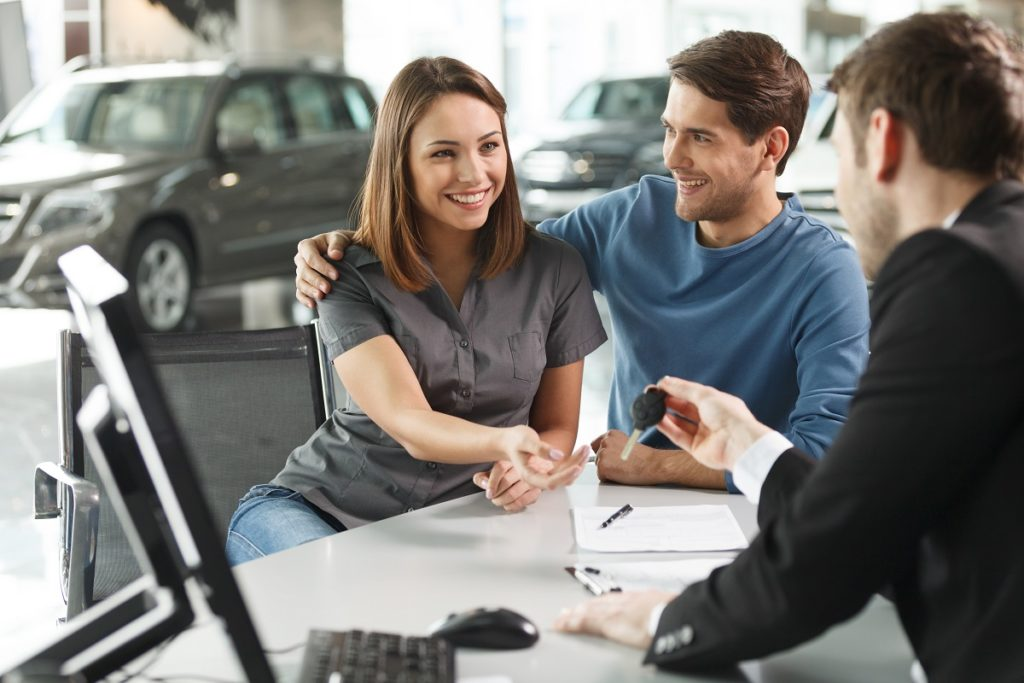 couple taking out a car loan