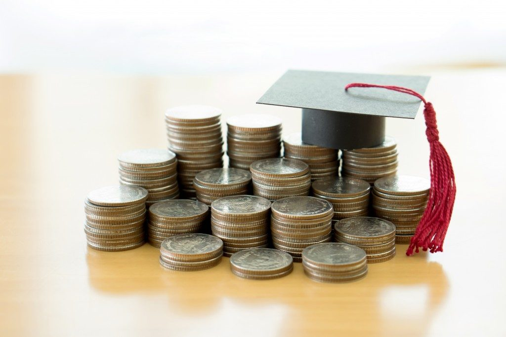student loan concept, toga and coins