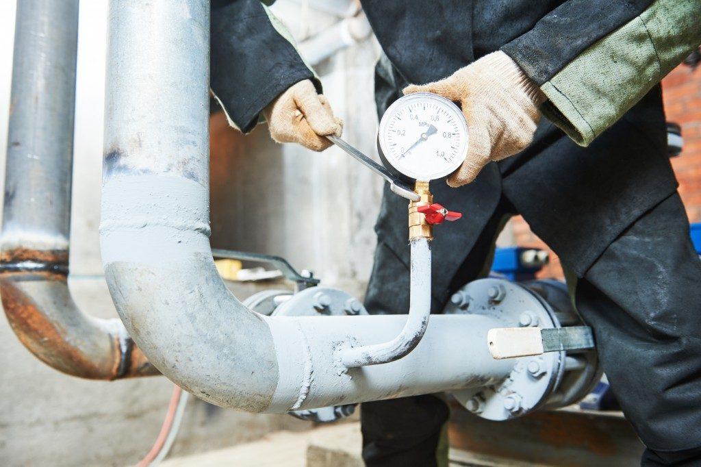 Man checking flow meter