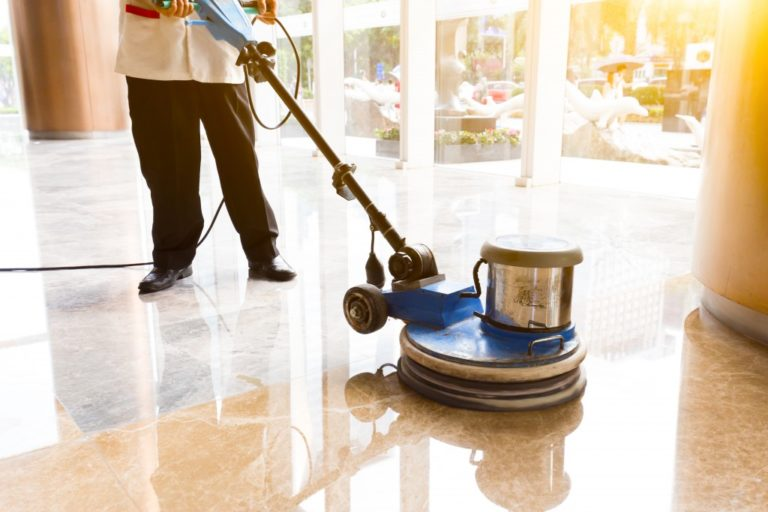 Man cleaning polishing commercial building floors