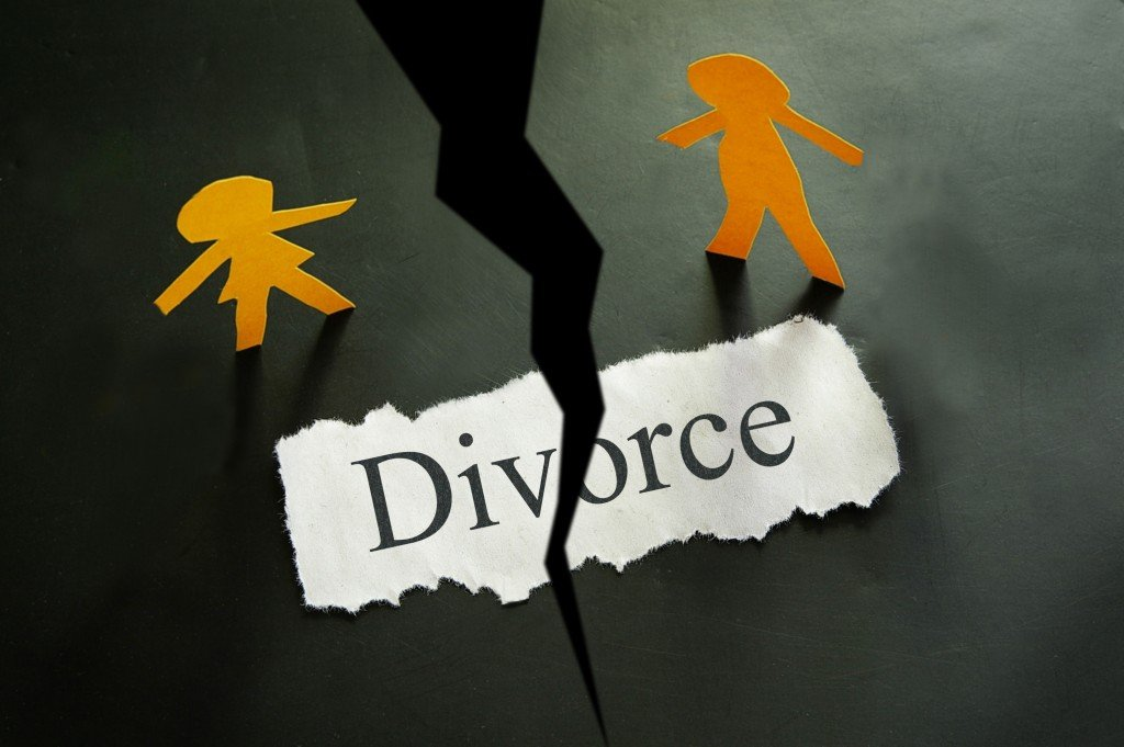 torn piece of paper with divorce written on it