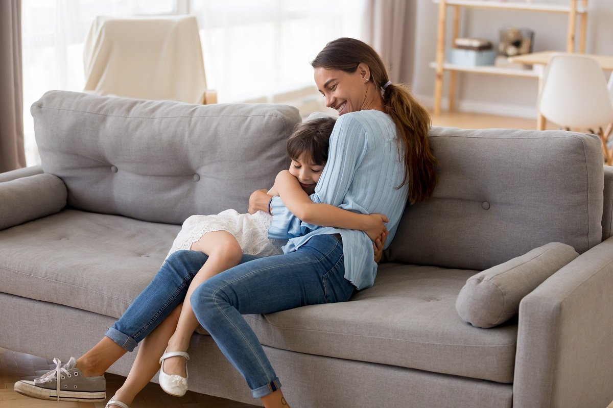 mother and daughter in couch
