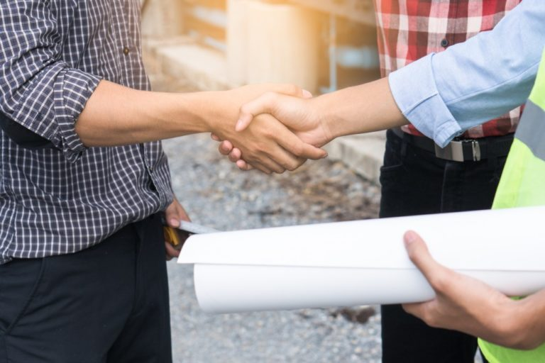 close shot of businesspeople shaking hands