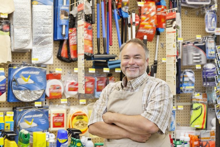 store owner posing near his products