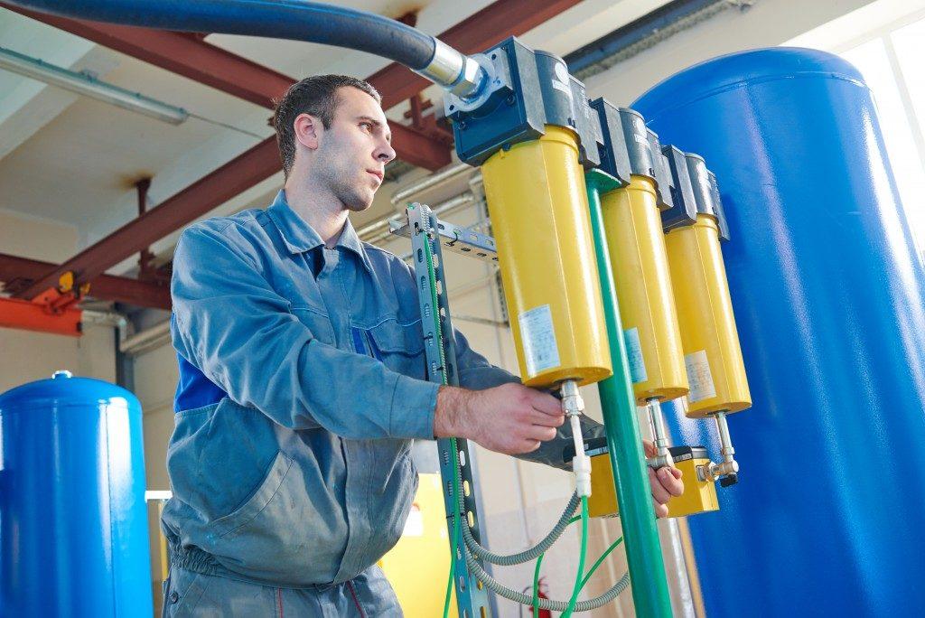 man monitoring the air filtration machine