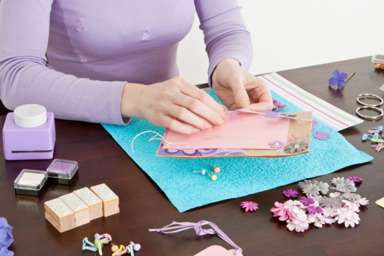 woman making a scrapbook