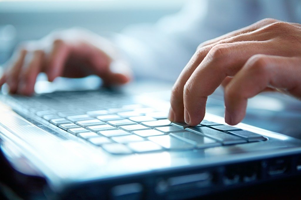 close up of typing on laptop keyboard