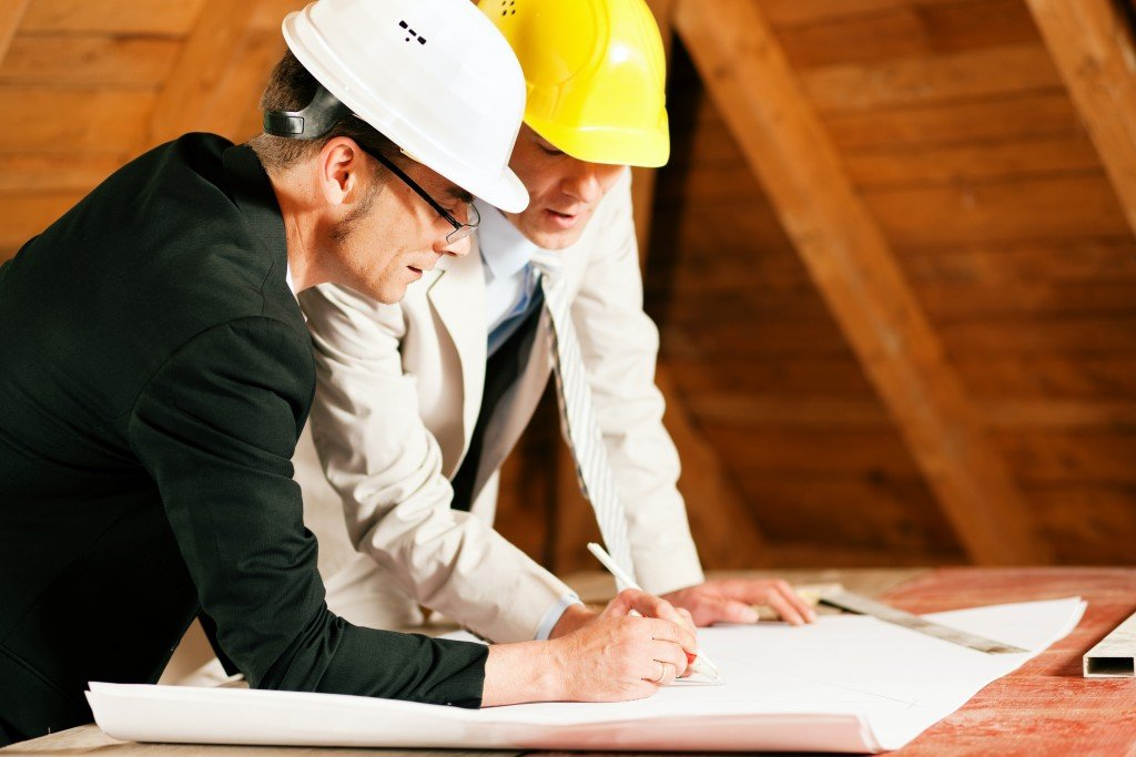 engineer and architect working on site