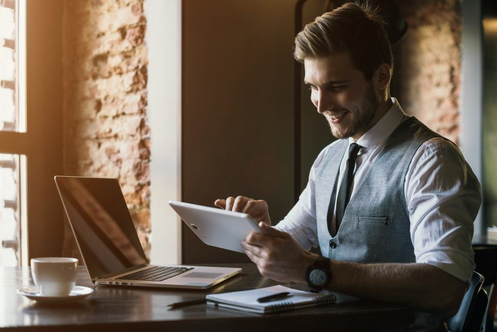 businessman looking at his tablet at work
