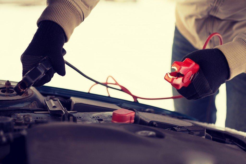 man repairing jumper cables
