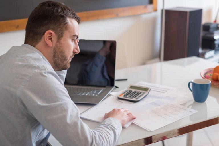 man computing his expenses