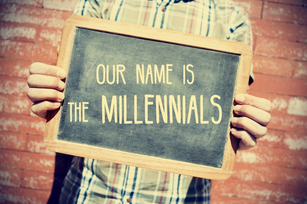 our name is the millenials written on a board