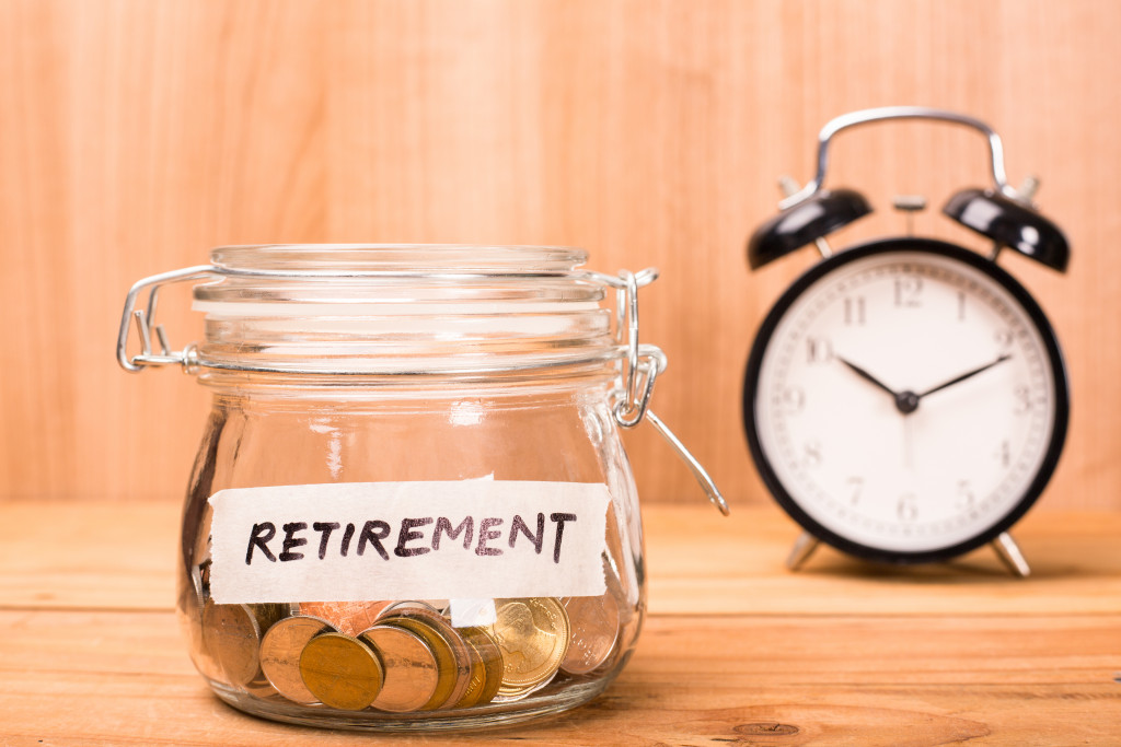 retirement jar with alarm clock in the background